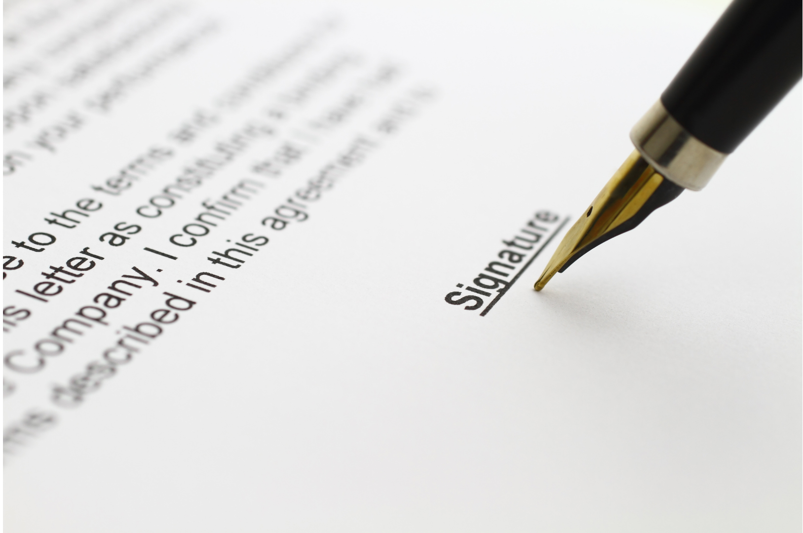 Male african hand write signature on legal corporate paper document